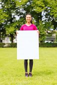fitness, park, advertising, information and people concept - smiling teenage girl with blank white b
