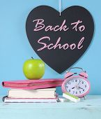 Back To School Heart Blackboard With Bright Pink And Colorful Stationery, Green Apple And Pink Clock