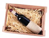 Bottles of wine in wooden box, isolated on white