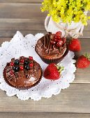 Tasty cupcakes on wooden background