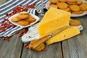 Cheese and crackers on wooden table close-up