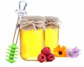 Jar full of delicious fresh honey and wild flowers, isolated on white