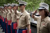 NEW YORK - MAY 23, 2014: U.S. Marines salute during the re-enlistment and promotion ceremony at the