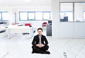 Portrait of a businessman in a meditation pose