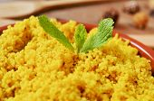 closeup of an earthenware casserole whit spiced couscous