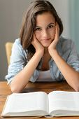 Teenage girl enjoy reading book student at home