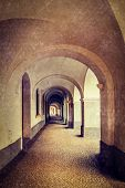 Vintage retro hipster style travel image of arcade in Prague, Czech Republic with grunge texture overlaid