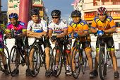 Unidentified People Group Ride Of Bicycle Travel In The City