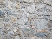 picture of fortified wall  - A photo of an old irregular stone wall - JPG