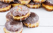 Stack of donuts with color glaze.