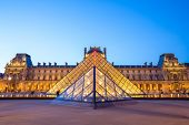 Paris - June 18: Louvre museum at dusk on June 18, 2014 in Paris. This is one of the most popular to