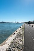 picture of bollard  - Quay with bollards and bridge in background Lisbon  - JPG