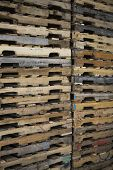 Detail shot of wooden pallets stacked in distribution warehouse