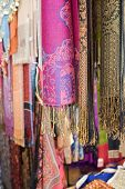 UAE, Dubai, colourful pashminas and fabrics for sale at Bur Dubai souq