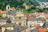BELLINZONA, SWITZERLAND - JULY 4, 2014: The Collegiate Church and town of Bellinzona, seen from Castelgrande. The Renaissance building was built in 1517 by Tomaso Rodari, builder of Como Cathedral.