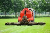 stock photo of spreader  - Injection of liquid manure with an liquid manure spreader in the Netherlands - JPG