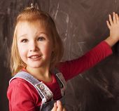 little cute girl in classroom