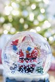 Closeup of snow globe with Santa Claus at home
