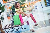 Female shopper speaking on cellphone in department store