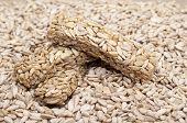 picture of sunflower-seed  - Kozinaki of sunflower seeds and sunflower seeds close - JPG