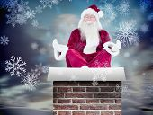 Santa Claus sits and meditates against snowy landscape with fir trees