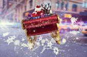 Santa flying his sleigh against blurred new york street