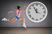 Composite image of fit brunette running against room with wooden floor