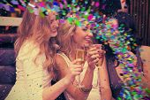 picture of champagne color  - Happy friends drinking champagne together against colour curve - JPG