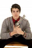 Man In Sweater Holding Pistol Looking