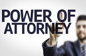 Business man pointing to transparent board with text: Power Of Attorney
