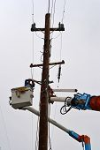 Lineman Electrician Working on Pole