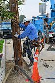 Worker Pole Climbing