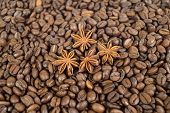 Lots Of Coffee Beans. And Four Anise Stars. Background. Shallow Depth Of Field.