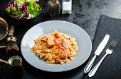 stock photo of endive  - Farfalle with tomato sauce and roasted salmon fresh endive salad - JPG