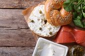Fresh Bagel With Cheese, Red Fish And Ingredient Top View