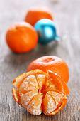 Fresh ripe mandarins and Christmas decoration background