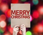 Merry Christmas card with colorful background with defocused lights