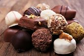 Pile of chocolate candy on wooden rustic background