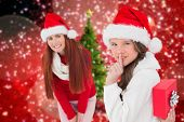 Mother and daughter with gift against christmas tree