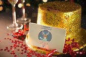 2015 card on table set for party with gold hat and champagne