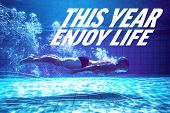 Fit swimmer training by himself against this year enjoy life