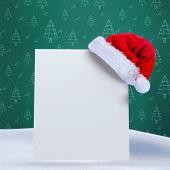 Santa hat on poster against green christmas tree pattern