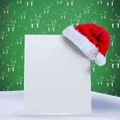 Santa hat on poster against green reindeer pattern