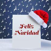Feliz navidad against blue reindeer pattern