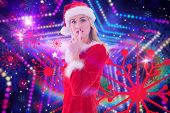 Festive blonde keeping a secret against digitally generated star laser background