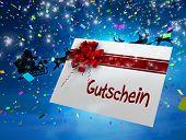Santa flying his sleigh behind gift card against blue sky
