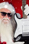 Father Christmas shows a guitar against red snowflake background