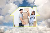 Woman giving boxes to her husband while they are moving against blue sky with white clouds