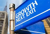 Growth Next Exit blue road sign