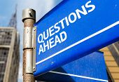 Questions Ahead blue road sign